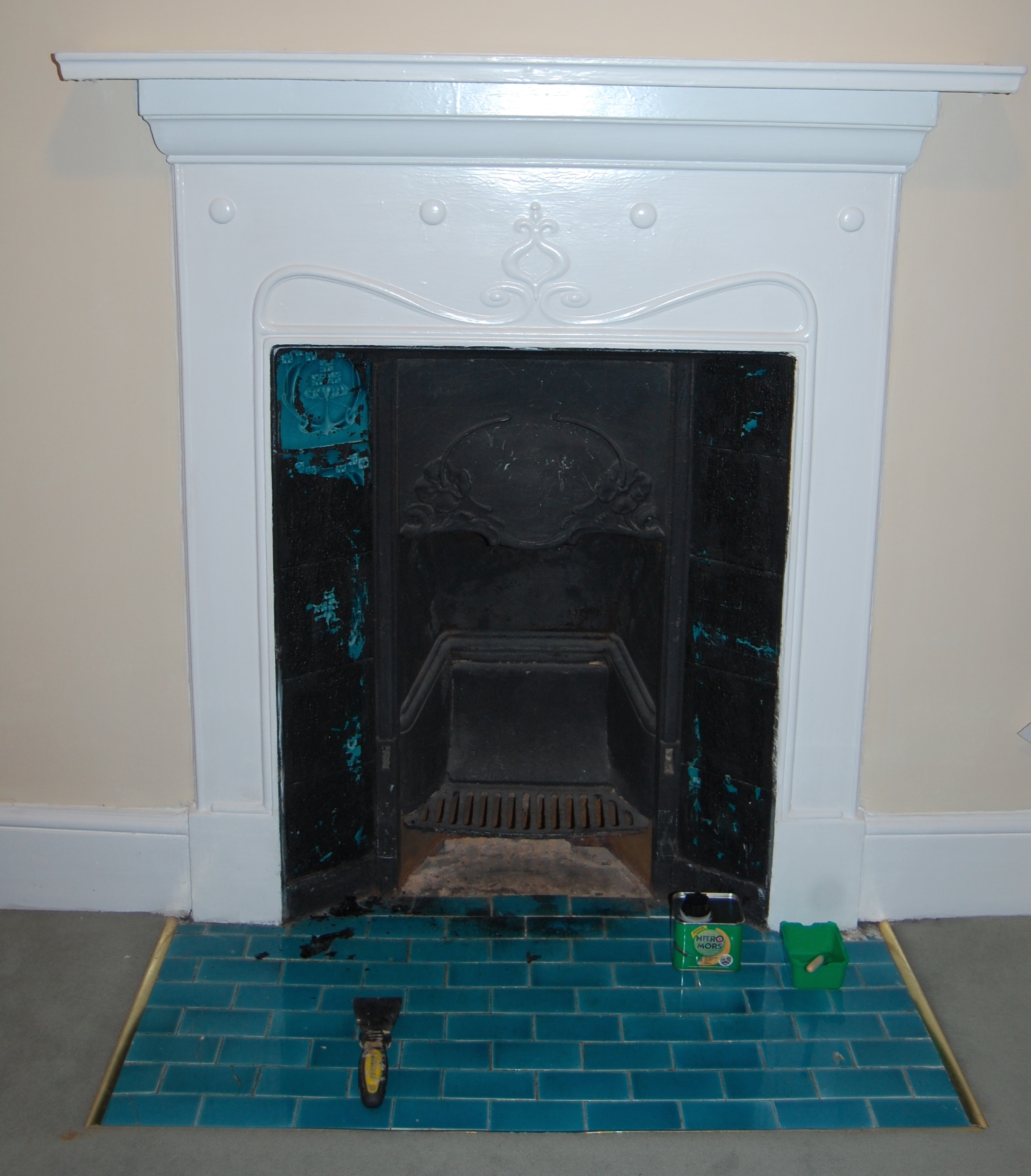 pretty tiles hidden for years under black paint the english mother